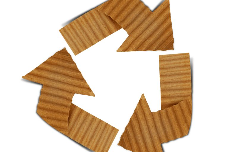 brown corrugated cardboard arrows in the shape of the recycling symbol
